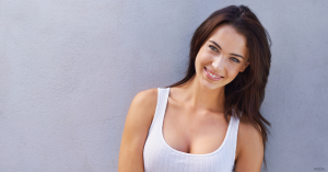 A woman in Northbrook, IL, is happy with the results of her breast augmentation.
